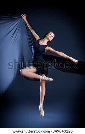 Graceful beautiful ballet dancer posing at studio. Art concept.  - stock photo