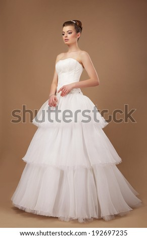 Graceful Bride in Long Classic Wedding Dress Posing - stock photo