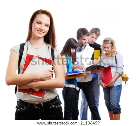 Graceful female student with books in hands looking at camera. On a background classmates