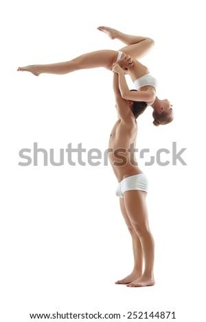 Graceful girl hanging upside down on her partner - stock photo
