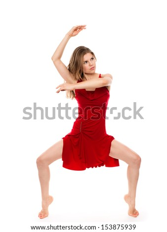 Graceful modern ballerina dancer in move. Nice Caucasian female performer standing on tiptoe in dancing pose. Isolated over white background. - stock photo