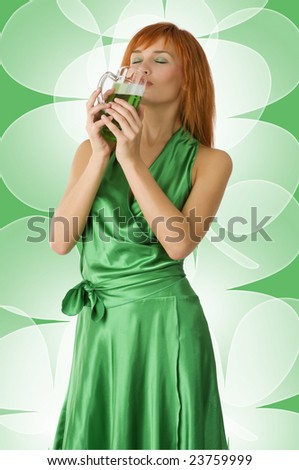 graceful red head girl in act to drink green beer with pleasure