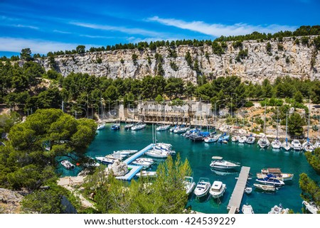 Graceful sailing yachts in the deep sea gulf. The picturesque fjord with turquoise water at coast of the Mediterranean Sea. National park of Calanques in Provence, between Marseille and Kassis - stock photo