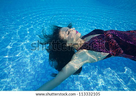 Graceful woman under water