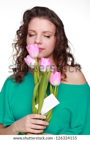 Graceful woman with pretty pink tulips on Holiday theme