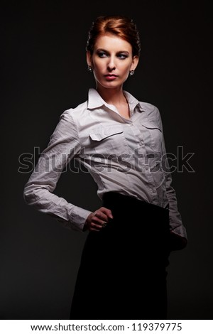 graceful young model over dark background - stock photo