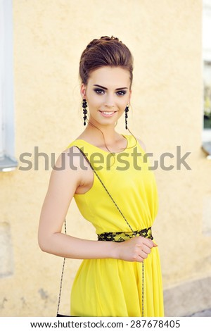 Graceful young woman in elegant dress - close up  - stock photo