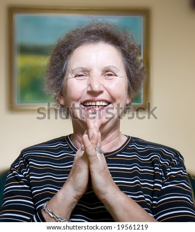 Gracious senior lady portrait inside - stock photo