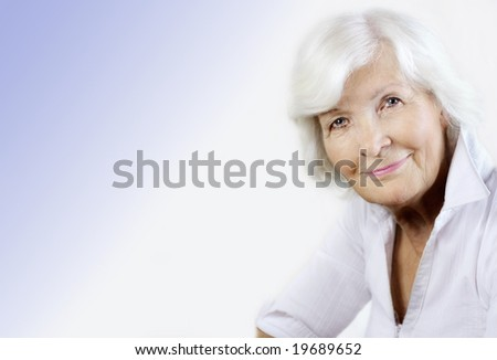 Gracious senior woman portrait with copy-space - stock photo