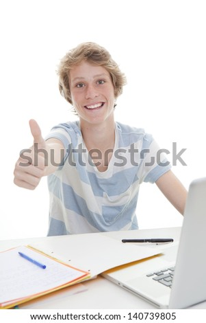 grade A student studying in class with thumb up - stock photo