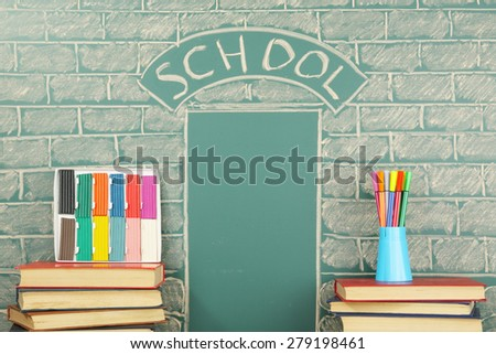 Grade school unusual concept with books, plasticine and felt pen - stock photo