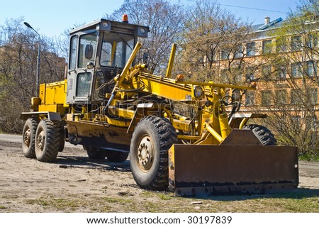 Grader building a new road in the city