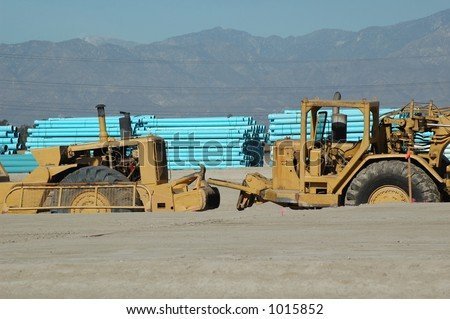 Graders and Water Main on New Housing Development Site - stock photo
