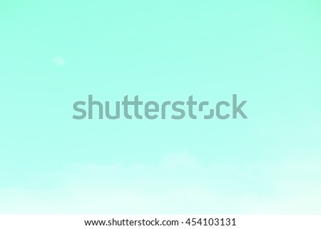 Gradient of cyan color, soft color gradient of fluffy cloud and half moon on a day light sky background, use for business presentation background or desktop wallpaper - stock photo
