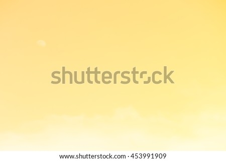 Gradient of yellow gold color, soft color gradient of fluffy cloud and half moon on a day light sky background, use for business presentation background or desktop wallpaper - stock photo