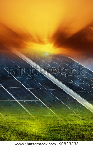 Gradient solar panel with sunset and green field background - stock photo