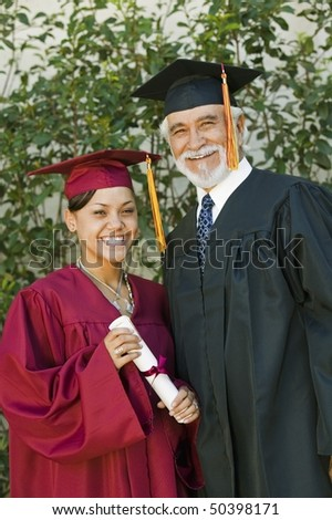 Graduate and dean outside, portrait - stock photo