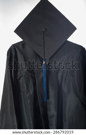 Graduate cap and gown, 3/4 view