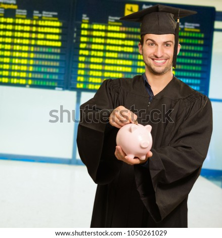 Graduate Man Inserting Coin, Indoors