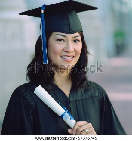 Graduate smiling for the camera