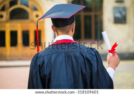 graduate student hands holding diploma from the back - stock photo
