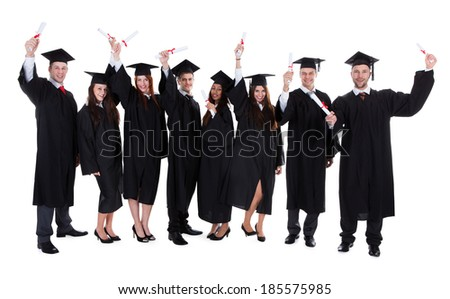 Graduate students raising hands. Isolated on white background - stock photo