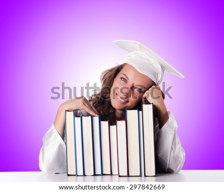 Graduate with book against the gradient  - stock photo
