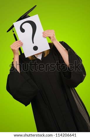 Graduate Woman Holding Paper With Question Mark Symbol On Green Background - stock photo