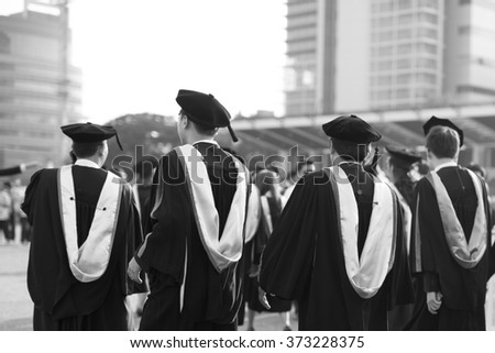 Graduates are walking in line to get your degree,monochrome - stock photo