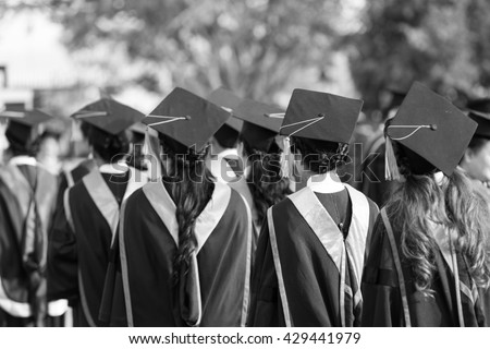 Graduates are walking in line to get your degree,monochrome. - stock photo