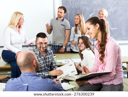Graduates consulting with their lecturer informally during a break  - stock photo