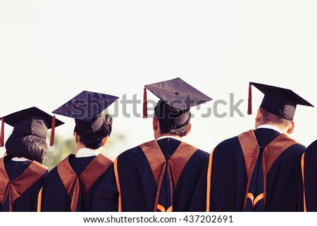 Graduates , Graduates are stand up in line to get your degree ,vintage style , Graduates stand up , Graduates people , Graduates cap,Graduates group,Graduates man ,  Graduates women , Graduates campus - stock photo