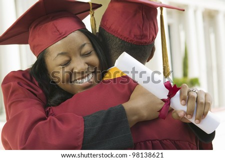 Graduates Hugging - stock photo