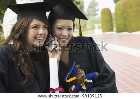 Graduates Listening to Cell Phone