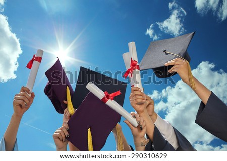 graduates stutents  throwing graduation hats in the air. - stock photo