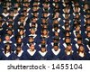 Graduating class in caps and gowns at commencement. - stock photo