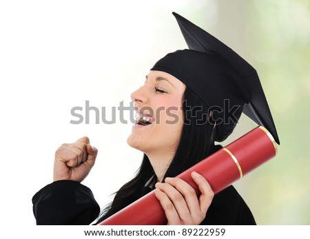 Graduating glory and pride, happy female with diploma in hands