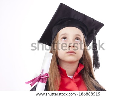 graduation and looking at the little girl proudly - stock photo