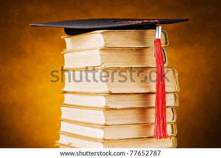 Graduation cap and books - stock photo