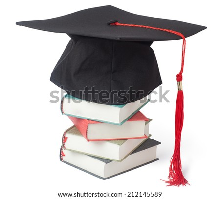 Graduation cap and books isolated on white background - stock photo