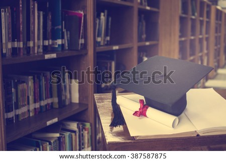 graduation cap and Books step in Library room,Education concept - stock photo