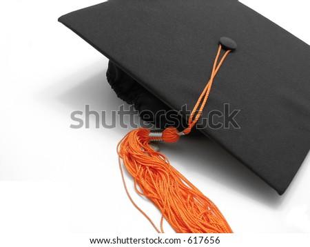 Graduation cap and tassel - stock photo