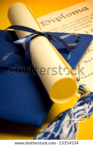 Graduation cap diploma and tassel - stock photo