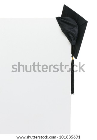 Graduation cap on blank billboard - stock photo