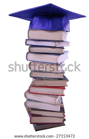 Graduation cap on top of book stack - stock photo