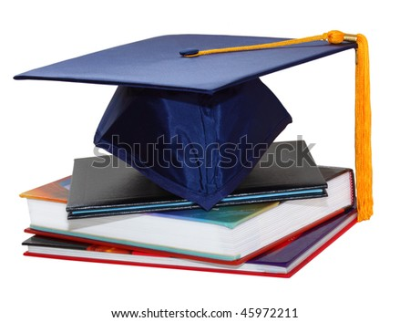 Graduation cap over black leather diploma cover and books - stock photo