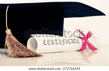 Graduation Cap with Degree Isolated on White Background - stock photo