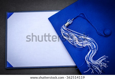 Graduation Day. Mortarboard, tassel and blank diploma with copy space. - stock photo