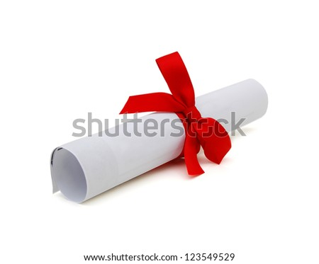 Graduation diploma scroll tied with red ribbon isolated on white background - stock photo