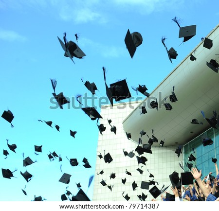 Graduation - flying hats in the air - stock photo